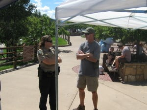 Mike Berry of Tri-County District visits with a park ranger.