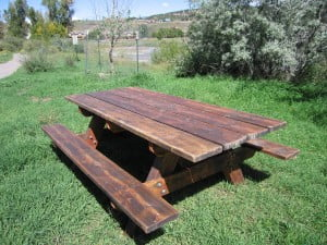 A newly sanded and stained picnic table.  Courtesy of our fabulous volunteers!