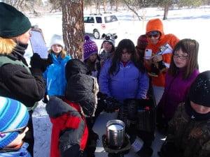 Melting snow samples to determine SWE